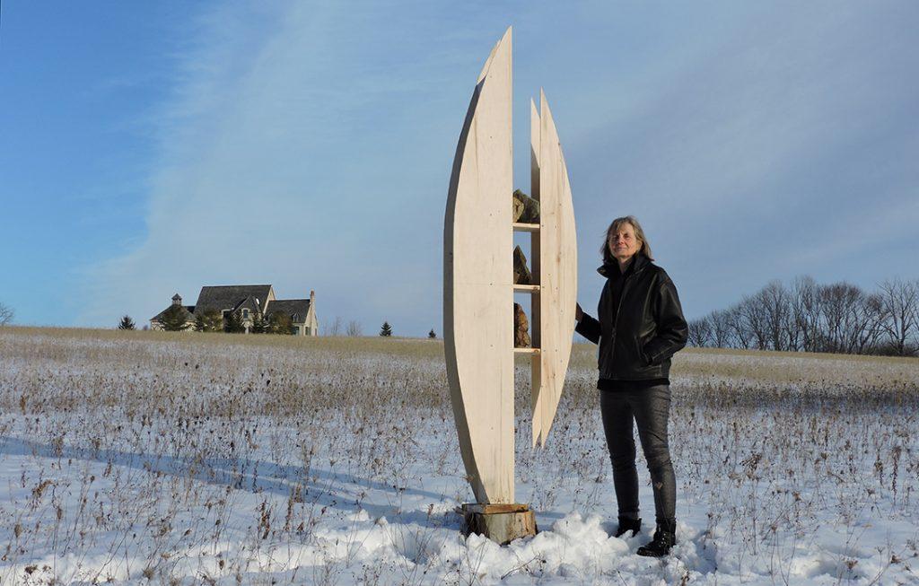 Alice Vander Vennen artist stands with sculpture prototype